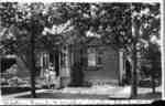 Veda Luke, Pearla Luke and Millie Luke standing in front of the residence of W.J. Luke, c.1907