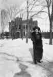 Marjorie Barclay standing outside the residence of George Conrad Gross, c.1910