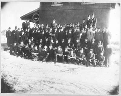 Group of Men in front of Port Whitby and Port Perry Railway Station