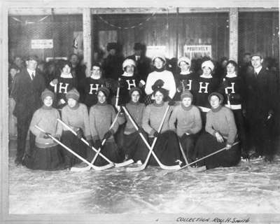The Whitby Girls Hockey team and the Hailybury team at the Haileybury Arena, 1911. <br>Courtesy the Whitby Public Library.