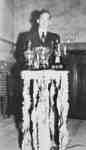 Gerald Bracey with High School Athletics Trophies, 1947
