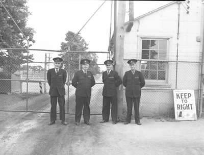 Four men standing on guard