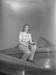 Unidentified woman sitting on a Ercoupe airplane.