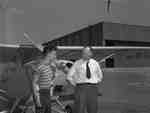 An unidentified man and flight student standing in front of Aeronca Champion