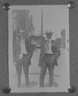 Two men standing on Brock Street
