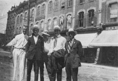 Group of men at Four Corners