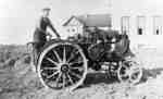 Louis Northam Operating a Tractor in front of Cottages at Ontario Hospital Whitby, c.1915