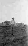 Man Standing in Front of Cottages, Ontario Hospital Whitby, c.1916