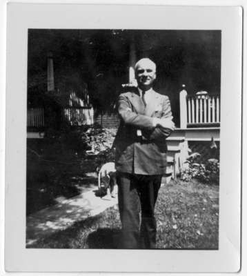 Ernest John Ellis (1889-1942) standing in front of a house in Toronto