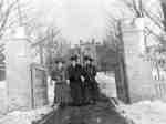 Three students at College Gates, c.1908-1909