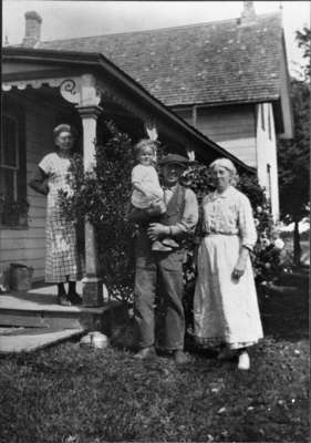 Carmichael family standing in front of house, c.1915