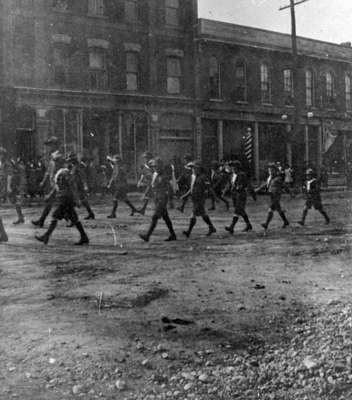 Boy Scouts Marching Along Brock Street in a Parade for Recruits, 1915
