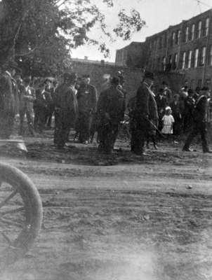 Officials standing on Dundas Street after a Parade, 1915
