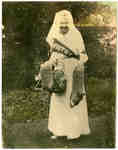 Mrs. John Tait Mathison with socks she knitted for soldiers, c.1915-1918