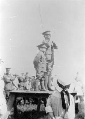 Major Bob Smith and a child standing on a makeshift reviewing stand, during 116th Battalion Soldiers Military Review, 1916