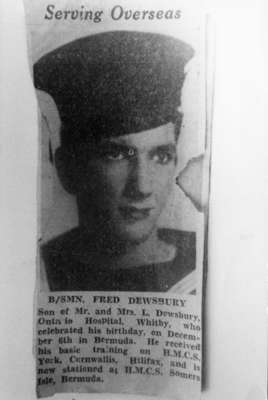 "Photo of newspaper clipping with headline ""Serving Overseas"" about B/Smn. Fred Dewsbury"