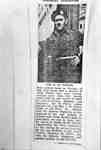 "Photo of newspaper clipping with headline ""Soldier Returns: TPR. O. ST. PIERRE"""
