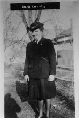 Photograph of Marg Kennelly standing outside
