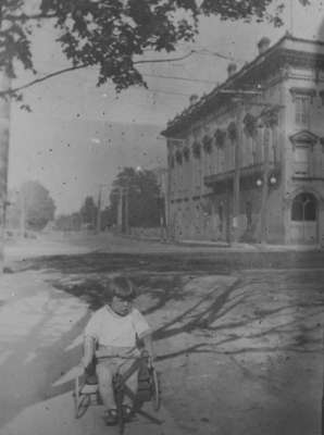 Unidentified Child in front of Town Hall, c.1916