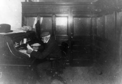 John Dundas Howden at his desk in the Post Office, c.1910-1924