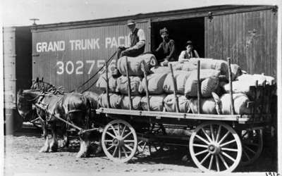 Hatch Manufacturing Company Employees Loading Horse Collars for Shipping (also known as the Buckle Factory), 1912.