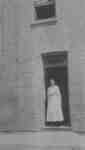 Laura Pellow standing in the doorway of Samuel Trees and Company (Blanket Factory), c.1915