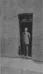 Samuel Trees standing in the doorway of Samuel Trees and Company (Blanket Factory), c.1915