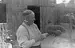 John Thomas with hen, c.1940