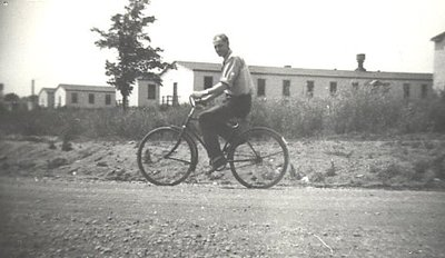 Defence Industries Limited - Dormitory buildings - employee on bicycle