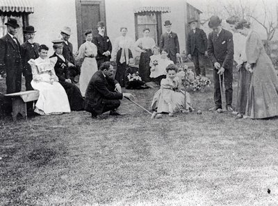 People playing croquet