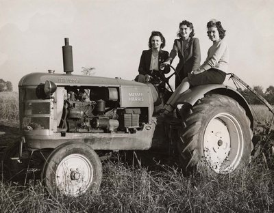 Three women on a tractor