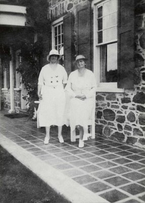 Two unidentified women in front of the Arnold House
