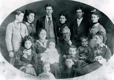 Mr. and Mrs. McGillivary and their 13 children