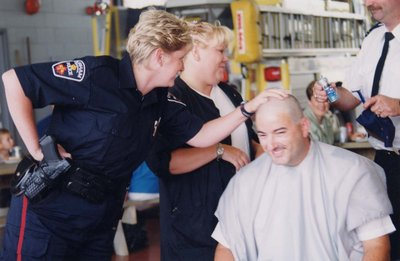 Firefighter Dave Lang shaving his head for charity