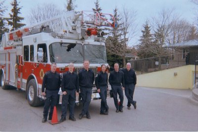 Ajax Firefighters in front of a fire truck