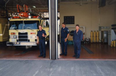 Three firefighters inside the Monarch Fire Hall