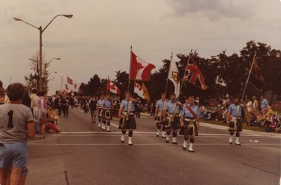 The Royal Canadian Legion bearing flags