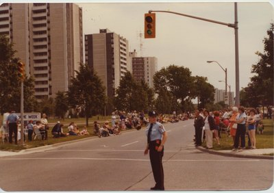 A Police Officer Directing Traffic for a Parade