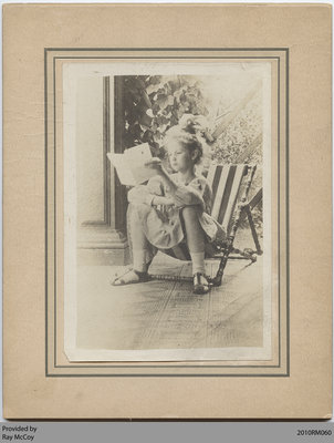 Constance Foley, age 9, reading a letter