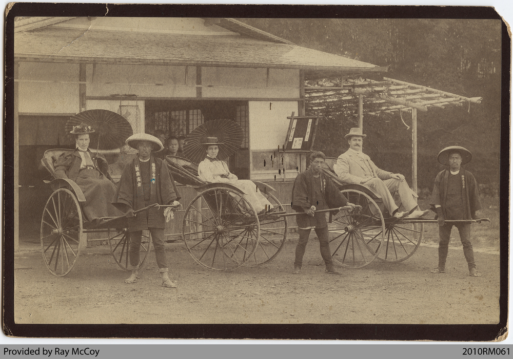 Photo of man and women with rickshaw drivers in Kyoto, Japan