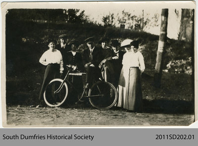 Group of People with Bicycle