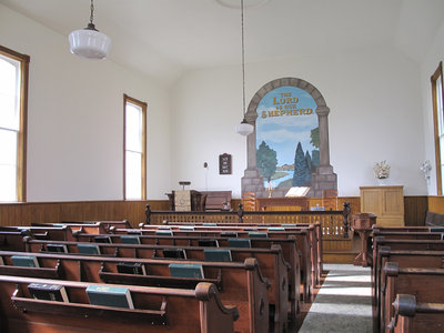 Interior view of the Salt Springs Church with the original mural painted in 1927.