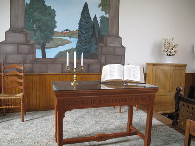 Communion Table, Bible Stand, and Candelabra.