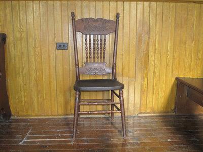 Chair, a legacy of Mr. T. J. Black.