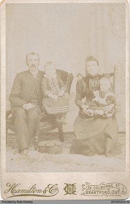 Photograph of Elgin Matthews and Bell Matthews with Hazel and Oscar