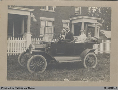 Abram VanSickle and His Family in front of Red Brick House