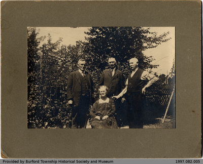 Outdoor Photo of Three Men and a Woman