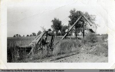 Backhoe Digging a Ditch