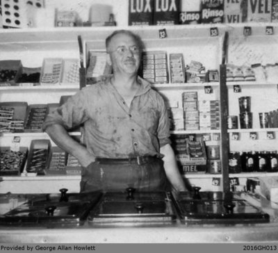 Photograph of Mr. Cronin Working at the Grocery Store in Glen Morris