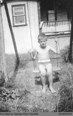 Photograph of George Allan Howlett outside of the Howlett House in Glen Morris